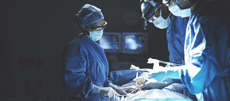 three doctors at the operating room