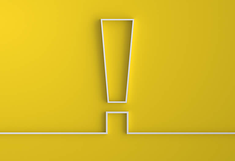 A yellow background with an exclamation point at the center.