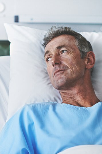 patient man lying in the bed