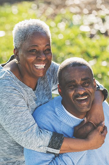 old black couple laughing together