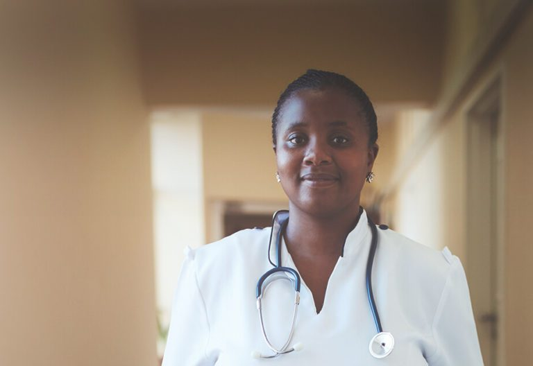a leading doctor wearing a stethoscope on her shoulder